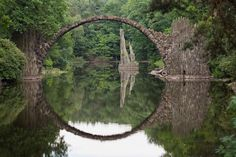 """Rakotz Bridge, Kromlau, Germany // """"Devil's Bridge"""" was built to create an optical illusion; regardless of the vantage point, it forms a perfect circle with its reflection in the waters of Lake Rakotzsee. Rakotz Bridge, Places To Travel, Places To See, Places Around The World, Around The Worlds, Beautiful World, Beautiful Places, Old Bridges, A Perfect Circle"""