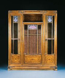 'AUX ALGUES', A CARVED MAHOGANY WROUGHT-IRON AND GLASS CABINET  LOUIS MAJORELLE, CIRCA 1907