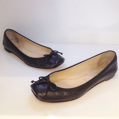 Christian Louboutin black leather ballerina flat. Leather bow accent at toe. Size 38.5. Please call (949)715-0004 for inquiries.