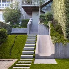 Rather than resist the natural slope of the Buena Vista Heights backyard, landscape architect Eric Blasen composed a well-considered, minimal, multi-terraced space that includes a concrete slide. Photo by: Marion Brenner Sloped Backyard, Backyard Playground, Modern Backyard, Backyard Slide, Steep Backyard, Modern Playground, Nice Backyard, Backyard Patio, Modern Landscape Design