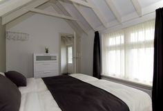de slaapkamer van appartement De Mataram