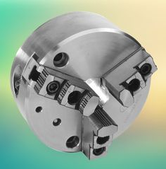 The conventional bevel gear and the scroll have been replaced by worm and wormwheel with three circular cams to operate the jaws. This gives the chuck an amazingly high mechanical advantage resulting in a grip many times more powerful than that of a scroll chuck.