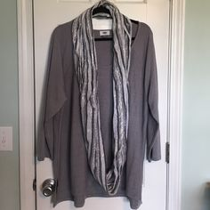 Old Navy 3/4 sleeve tunic. Soft, metallic silver/grey tunic.  Very flattering and versatile.  Scarf is NOT included.  Only worn once.  Comes from a clean, smoke free home. Old Navy Tops Tunics