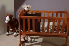 A Motorized Neck Allows The Bounceroo Stuffed Doll To Rock Baby's Cradle All On Its Own
