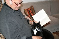 Johannes with book and cat is happiness