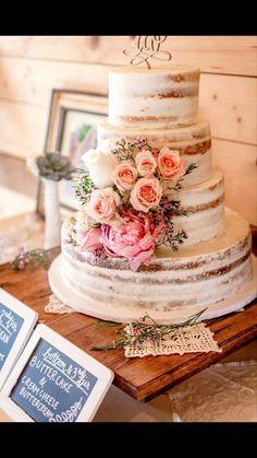 My beautiful semi-naked wedding cake - good amount of semi nakedness. Like the single spray of flowers.