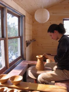Naomi Dalglish at her potter's wheel http://www.bandanapottery.com