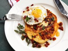 Chorizo and Halloumi Pancakes With Fried Eggs [8 oz Spanish chorizo; 2 Tbsp extra virgin olive oil; 2 Tbsp fresh oregano leaves; 7 1/2 oz all-purpose flour; 3/4 tsp baking powder; 1/4 tsp baking soda; 1 tsp salt; 2 tsp sugar; 5 large eggs; 2 Tbsp vegetable oil; 12 oz buttermilk; 4 (1- to 2-oz each) slices halloumi cheese]