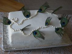 Peacock feather pearl necklace bridal shower cake. Pearls hand rolled in my special fondant.