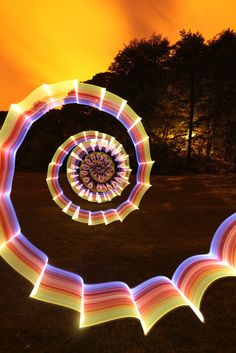 Ian Hobson is an expert at all kinds of impressive light art photography. When you first see his images, a collection called Waving Torches at Things, you won't believe that he creates them directly from his camera without the use of any digital manipulation.