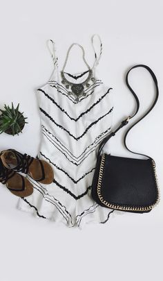 Ivory rayon, with a black chevron print, covers the relaxed bodice with adjustable spaghetti straps, darting, and attached shorts. #lovelulus