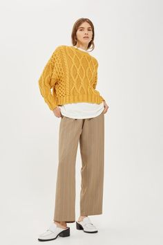 http://www.topshop.com/en/tsuk/product/clothing-427/jumpers-cardigans-6924635/cropped-cable-jumper-6956458?bi=140&ps=20