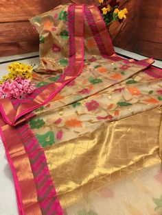 Own this exotic Tissue Banarasi look. This gorgeous Silk Mark Certified Tissue saree in Off White color with all over body multi color floral vine weaving and Hot Pink New Saree Designs, Kids Blouse Designs, Saree Blouse Neck Designs, Blouse Patterns, Organza Saree, Chiffon Saree, Cotton Saree, Banarsi Saree, Handloom Saree