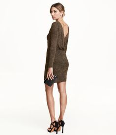 Short, fitted dress in glittery jersey with a draped, wrap-style back, metal chain at back of neck, and long sleeves. Lined.