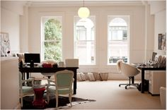 Love the mint chairs w/ white trim, cow hide rug! Creative Workspaces: Thinking Outside the Cube   Apartment Therapy