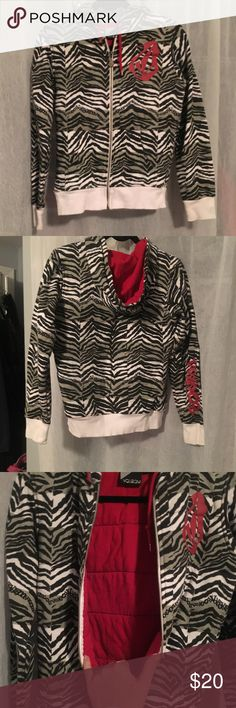 Volcom zebra print sweatshirt size small!! Really Cute volcom zebra print sweatshirt!! Only worn one time!! No rips or stains!! Size small!! Really thick and warm with the quilted material on the inside. Volcom Tops Sweatshirts & Hoodies