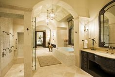 Amazing master bath...  Love the arches, love the curtainless shower, love the lighting, and the separate jacuzzi tub
