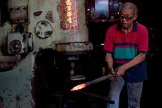 This blacksmith workshop makes anchors and iron products, and is run by 64-year old Teoh Huah Guan. A Yung Ting Hakka, he inherited it from his grandfather. It's been said that the first blacksmith in Penang was also a Yung Ting Hakka. Today, even though the anvil and hammer have been replaced by a hammering machine, blacksmithing is still a labour intensive process requiring skill and strength.
