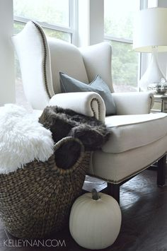 Fall Pottery Barn Thatcher wingback chair with fur throw and white pumpkins