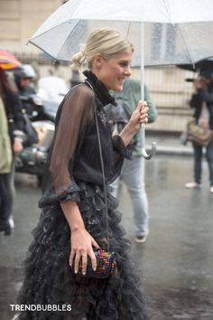 On the Street: couture Day 1 (Jean Paul Gaultier show). Despite the pouring rain in the streets of Paris, you can feel the sensual atmosphere around the couture fashion show by Jean Paul Gaultier (fall 2014). Umbrellas worn by the models and guests are the center of the street style in action. Despite the rain, the elegance splashed around! Read more http://trendbubbles.nl/not-dutch/ #streetstyle #street #style Soefie Valkiers @fashionata #fashionata #fashion