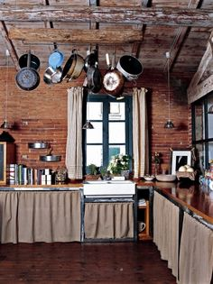 rustic beamed ceilings and wood floor, brick walls...this is a room filled with textures!