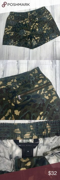 """Marc by Marc Jacobs Camo Shorts Camo print shorts have an elastic waist and zippered pockets. Zippers go front to back so the pockets are on the sides of the shorts. Measure 14.5""""inches across the top, 12.5""""inches long with a 3"""" inch inseam. 100% cotton Marc by Marc Jacobs Shorts"""