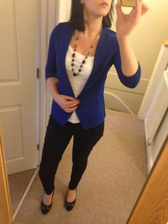 Royal blue jacket, white top, black drainpipe trousers, black block heels, navy and black necklace.