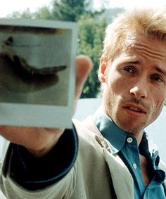 Memento (2000) I like the idea of using shots more from thrillers to give the film more of an uneasy feeling.