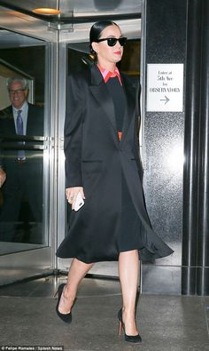Elegant: The 31-year-old star accessorised with a pair of black heels and classic sunglass...
