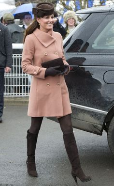 The Duke and Duchess of Cambridge headed to the races on Friday for the Cheltenham Gold Cup.    Kate, who is five months pregnant, hid her bump - nicknamed 'grape' - under a blush coloured Joseph coat, accessorised with a dark chocolate brown bow trimmed Betty Boop hat from Lock & Co, brown gloves, brown patterned tights and knee high brown boots.