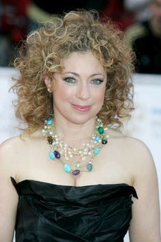 Alex Kingston  ~ BAFTA awards 2011 ~ wore a black strapless frock, which she accessorised with a turquoise necklace.
