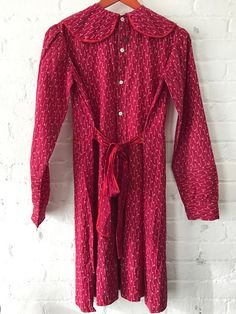 a8c47093202 Antique primitive late 1800s red calico long sleeve dress with mother of  pearl buttons on back