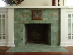 https://flic.kr/p/bHAsmF | celadon fireplace | A couple of Batchelder Revival tiles set against high-fired field tiles make a clean fresh fireplace for a Craftsman home.
