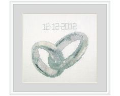 Cross stitch kit of two intertwining silver of platinum wedding rings. Very realistic and incredibly fun to give (also suitable for engagements!). With 9 colors DMC floss and 14 ct aida by Zweigart. Also available as a version with golden rings. Details cross stitch kit Name: Wedding