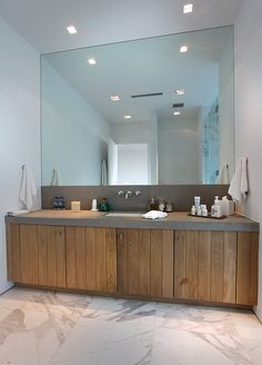 When you are bored with your bathroom design and layout, you can try to change one of the bathroom features. You may also replace the old bathroom walls and floor tile with the new ones which are more decorative. Bathroom vanity refacing is also a gr Wood Bathroom, Grey Bathrooms, Modern Bathroom, Mirror Bathroom, Bathroom Vanities, Mirror Vanity, Bathroom Mirror Wall, Modern Wall, Mirror Shelves