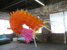 (my little girl loves this orange shrimp) balloon sculpture by artist Jason Hackenwerth