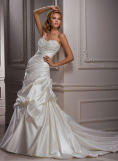 """""""Parisianna Bridal Gown"""" Enchanting combo of a satin gathered skirt and a beaded empire bodice, though the fit continues to a dropped waist. Not quite a fit and flare or ball gown, so I'd guess an A-line. She looks like she's ready to be swept off her feet!"""