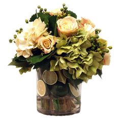 Silk hydrangea arrangement with faux roses and limes in a clear vase.     Product: Faux floral arrangementConstruction Mat...