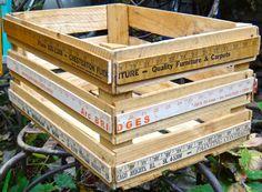 Vintage storage crate embellished with vintage yardsticks