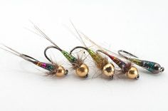 Glitter Nymphs are a new take on the beadhead nymph.  They look like they'd be effective in dark or high water. Also, could be a good dropper fly on a steelhead rig. (tyed by Lucian Vasies)
