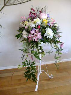 Small pedestal arrangement of autumn garden flowers