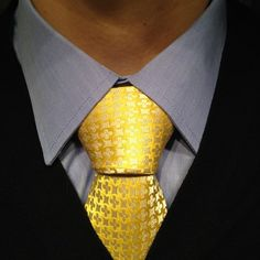 The big Balthus necktie knot. Like a big gold trophy.