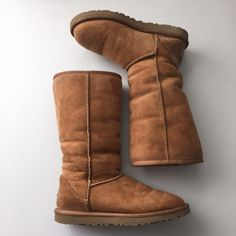 UGG Classic Tall Bomber Boot Worn a handful of times. Chestnut color. Boots have been sprayed with UGG sheepskin protector. Authentic. Purchased from Zappos several years ago. Comes with the original box, authenticity cards/sticker. These boots run big in my opinion. I wear a 5.5-6 and these fit me. Tag is slightly frayed on the back right boot. UGG Shoes Winter & Rain Boots