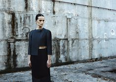 DZHUS AW15 Skew Shirt and Tucked Skirt #dzhus #design #fashion #conceptualfashion #edgyfashion #ukrainiandesigner #avantgardefashion #avantgarde #avantgardewomenswear #conceptualwear #conceptualclothing #minimal #black #totalblack #allblack #healthgoth #darkwear #monochrome #architecturalfashion #construction #structured #complexcut #geometry #angular #complexcut #pleats #futuristic #designer #fashionbrand #folds #trend #industrial #concrete #brutalism #intellectualfashion