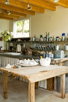 look at table top and curtain for freezer bar and love the hanging canisters.