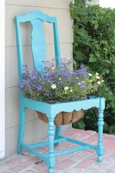 Repurpose a broke chair into a pretty planter for your porch! Add a coir-lined basket in place of the seat, top with a couple coats of brightly colored paint, and you've got a porch-worthy perch of a planter. by delia