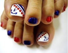 Sailor-themed toe nail art in hues of red, white and blue. Read more on www.producingfashion.com