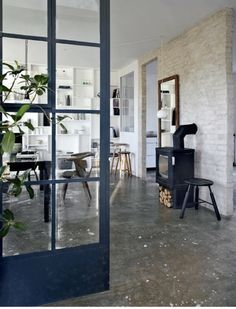 Concrete floors and navy door frame. Femina. Photo by Kira Brandt / Glotti Press.