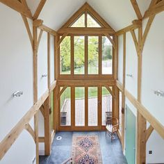 Dramatic entry hall in green oak from Oakwrights, in the U.K. #timberframe