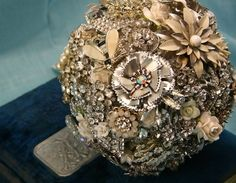 Rhinestones and pearls are a girls best friend!  Brooch bouquets for unique brides!